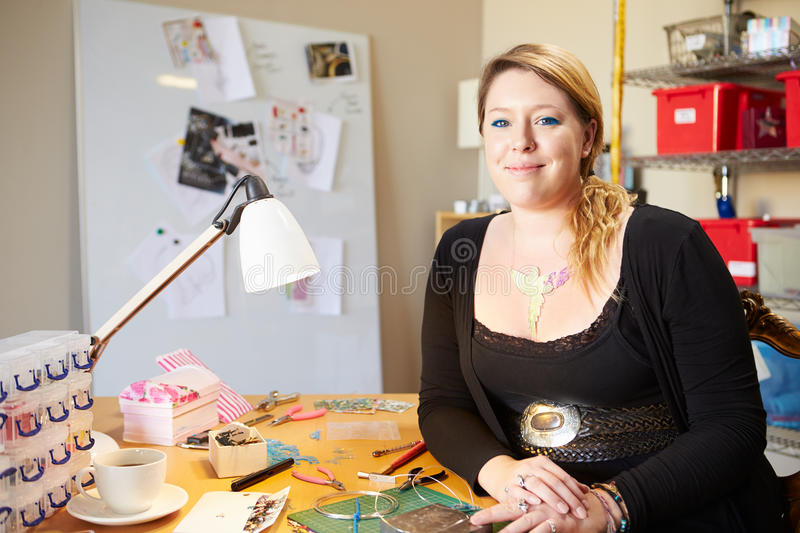 Portrait Of Young Woman Making Jewelry At Home royalty free stock photography