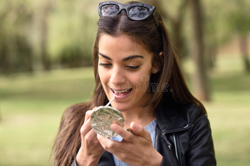 Portrait of young woman making up herself royalty free stock photo