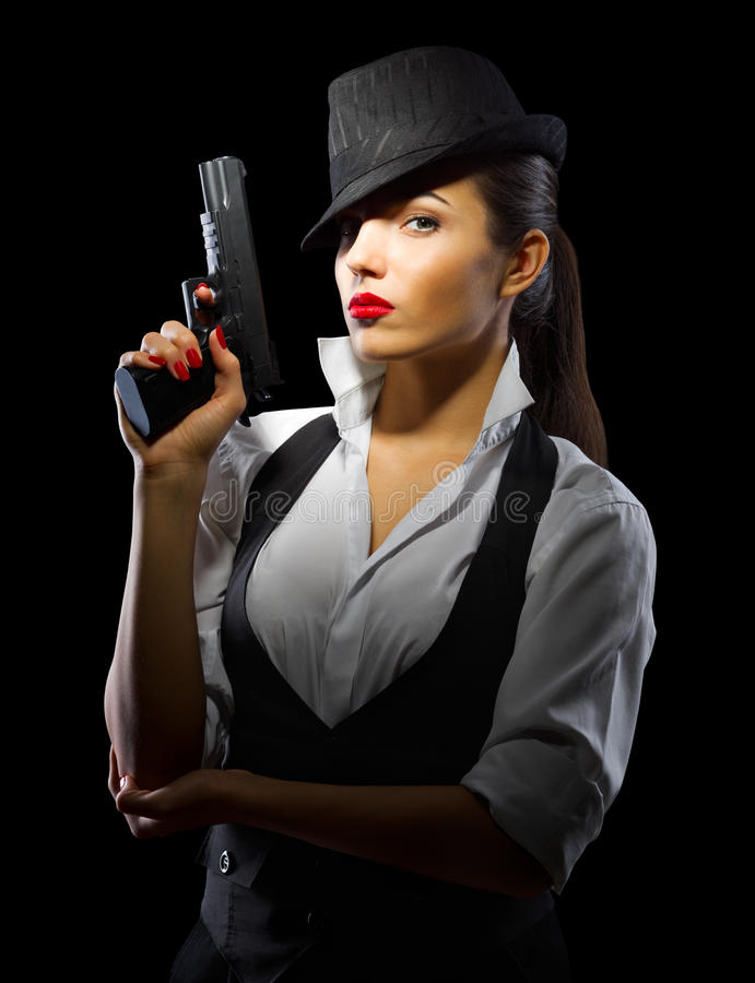 Portrait of young woman in manly style with gun. Isolated royalty free stock photo
