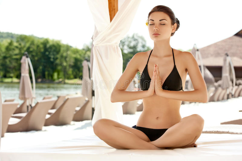 Download Portrait Of Young Woman Meditating In Pose Of Lotus. Stock Photo - Image of crossed, serene: 33149934