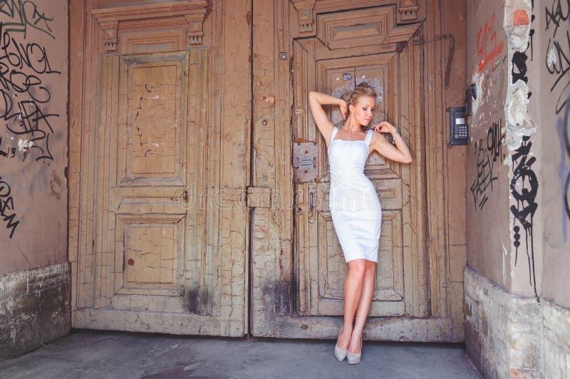 Portrait young woman, model of fashion wearing white dress stock image