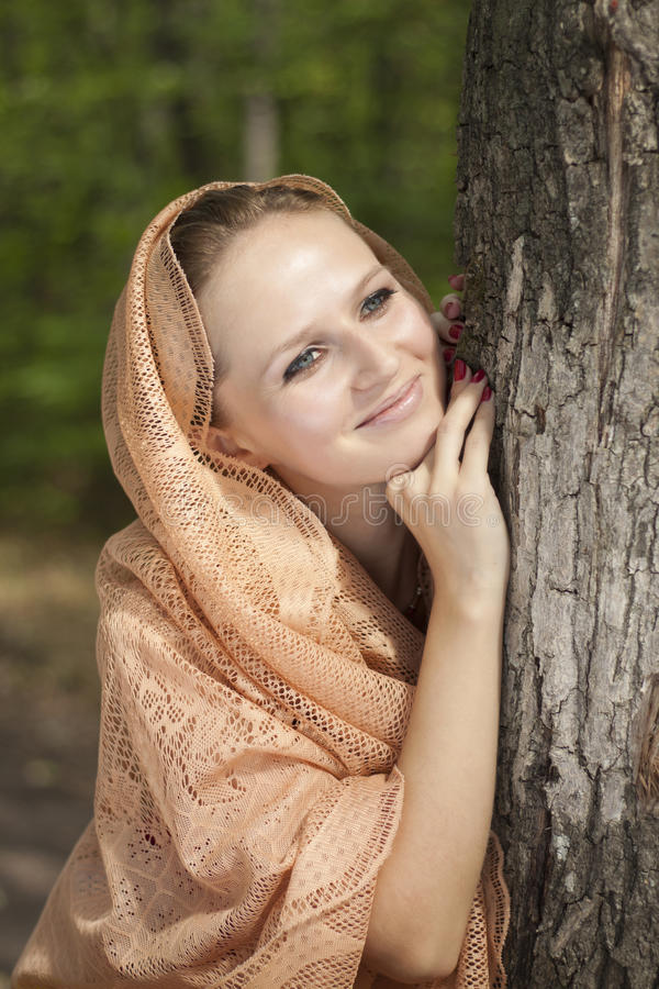 Portrait of a young woman near the tree stock photo