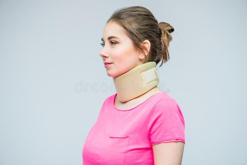 Portrait of young woman with a neck injury, osteochondrosis collar to prevent and physiotherapy. Pain treatment. Neurology, Osteop royalty free stock photo