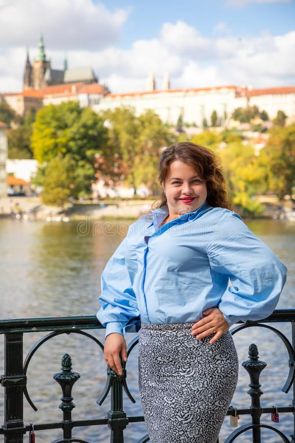 Portrait of young woman Old Town of Prague and river Vltava background in sunny september day royalty free stock photo