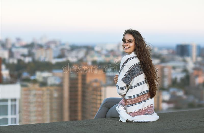 Young woman outdoors on city background in sunny day royalty free stock images