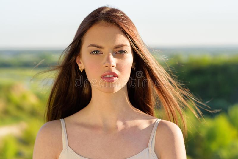 Portrait of a young woman outdoors. royalty free stock photography