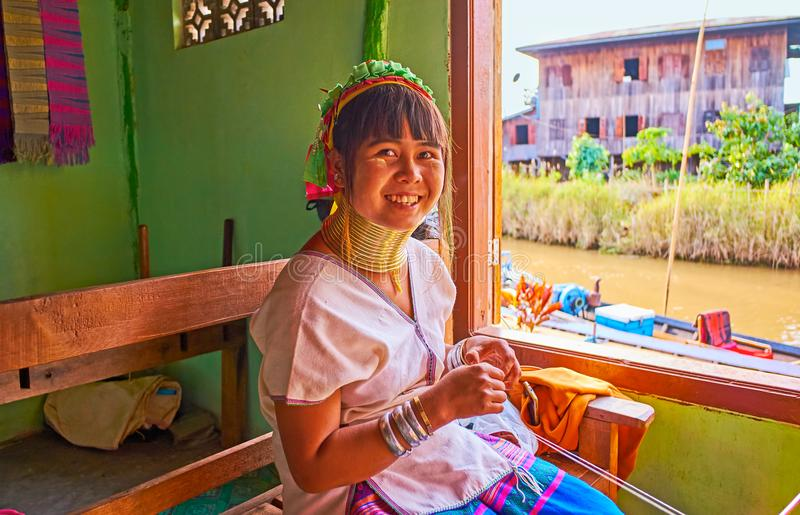 The portrait of young woman of Padaung Kayan tribe, Inle Lake, M stock photo