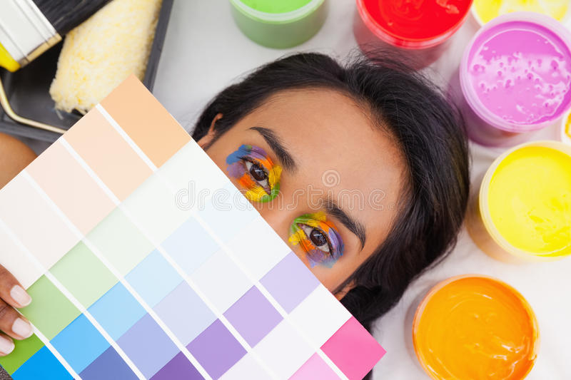 Portrait of a young woman with paint samples stock image