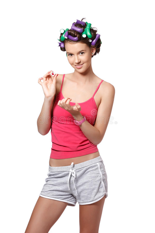 Download Portrait Of A Young Woman Painting Her Nails Stock Photo - Image: 25521144