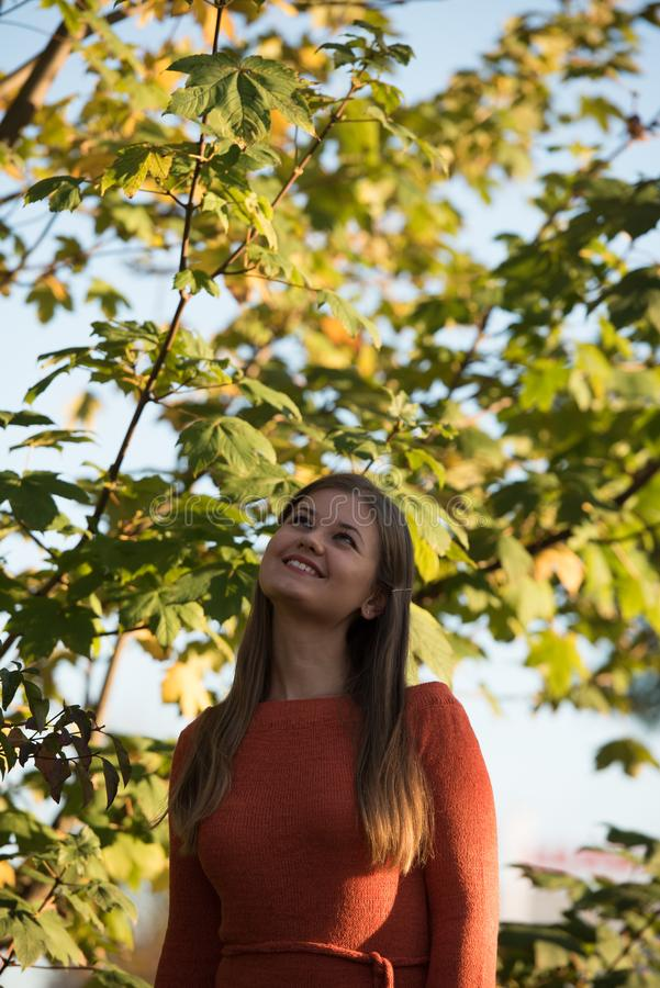 Portrait of young woman in park stock photos