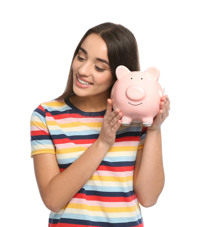 Portrait of young woman with piggy bank royalty free stock images