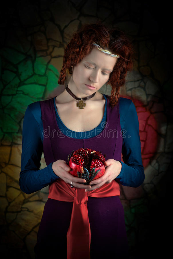 Retro style portrait of woman with pomegranate stock photography