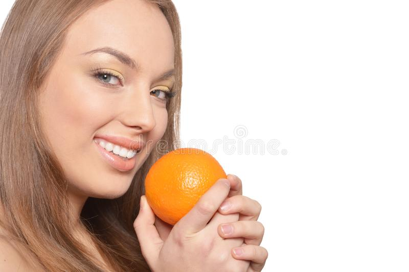 Portrait of young woman posing with orange. Isolated on white background royalty free stock photo