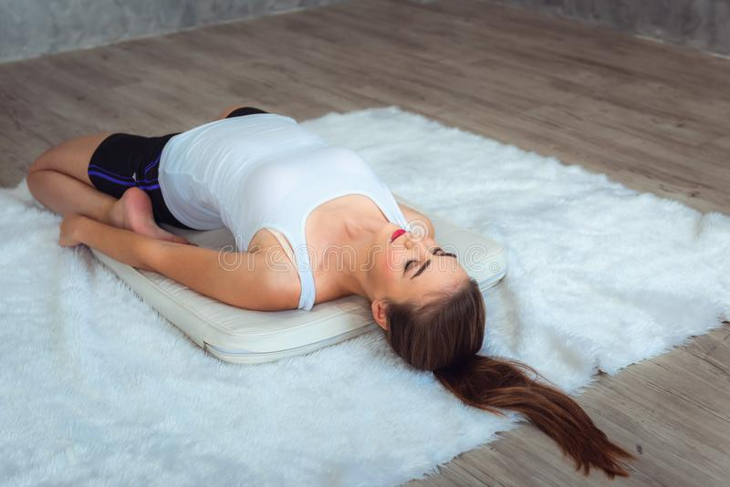 Portrait of young woman is practicing yoga in gym stock photography