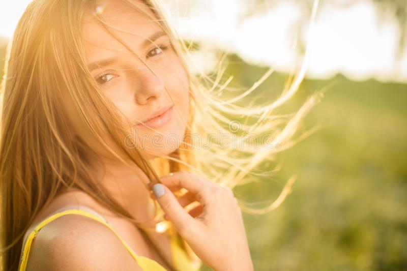 Portrait of young  woman on a spring/summer sunny day royalty free stock photo