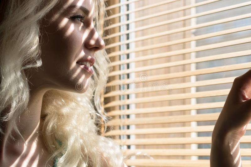 Portrait of a Young Woman near the Window. Copy Space stock photography