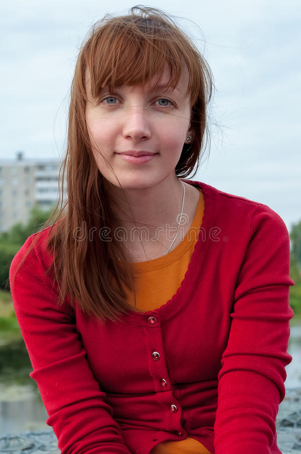 Portrait of young woman in red blouse stock photo