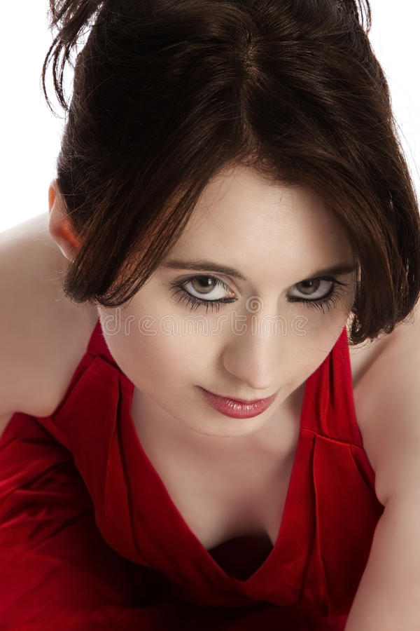 Portrait of a young woman in red dress stock photography