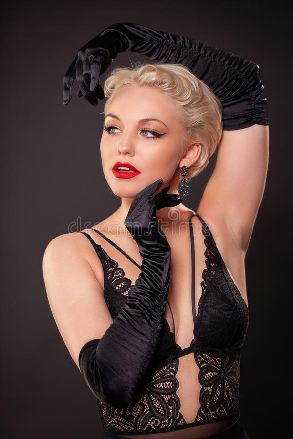 Portrait of young woman with red lips, long false eyelashes in retro style. Curly. Burlesque royalty free stock images
