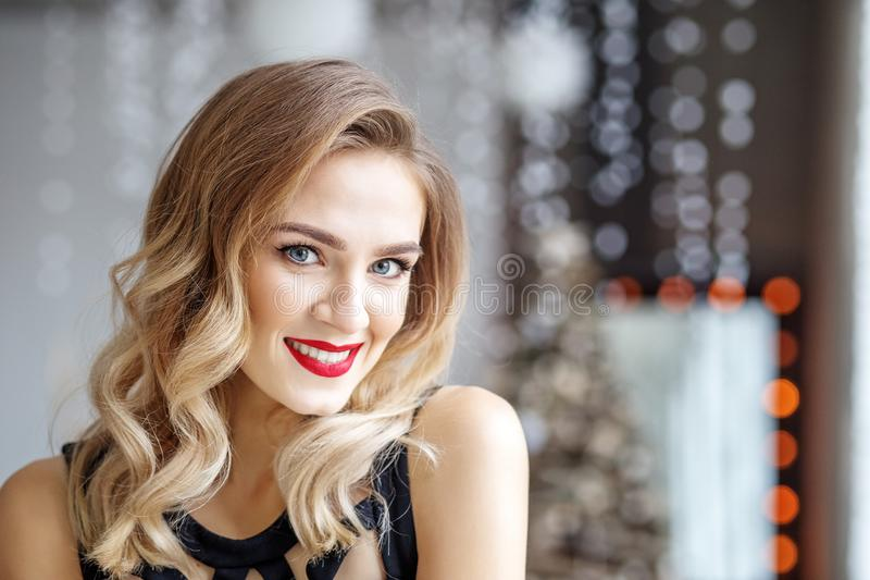 Portrait of a young woman with a red lipstick for Christmas. Con stock photo