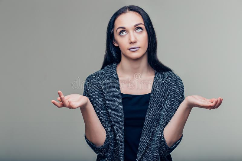 Portrait young woman shrugging shoulders who cares so what I don`t know gesture royalty free stock images