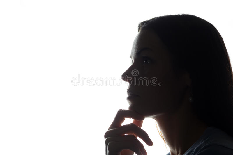 Portrait of a young woman, side view stock photos