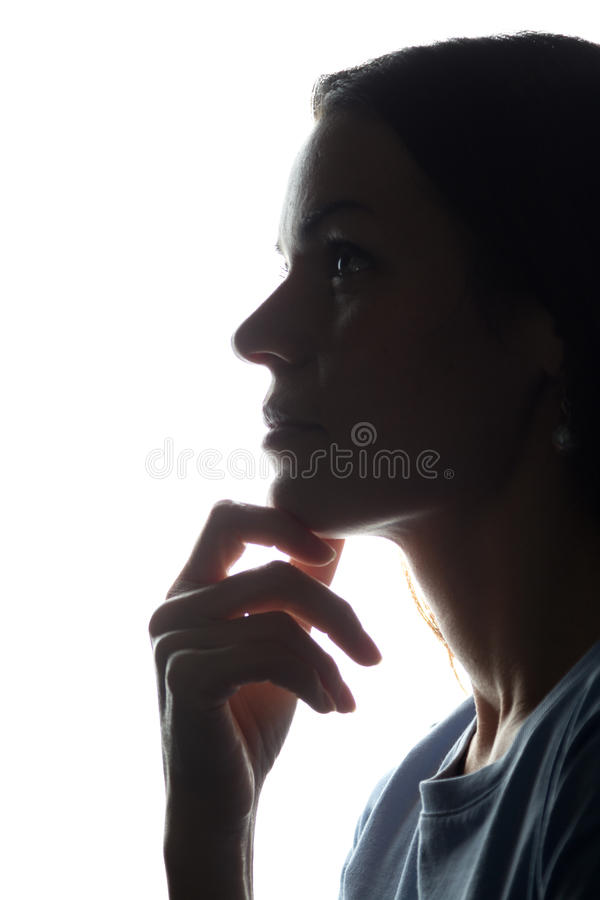 Portrait of a young woman, side view royalty free stock image