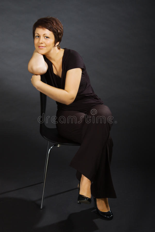 Download Portrait Of Young Woman Sitting On Chair Stock Image - Image: 11433087