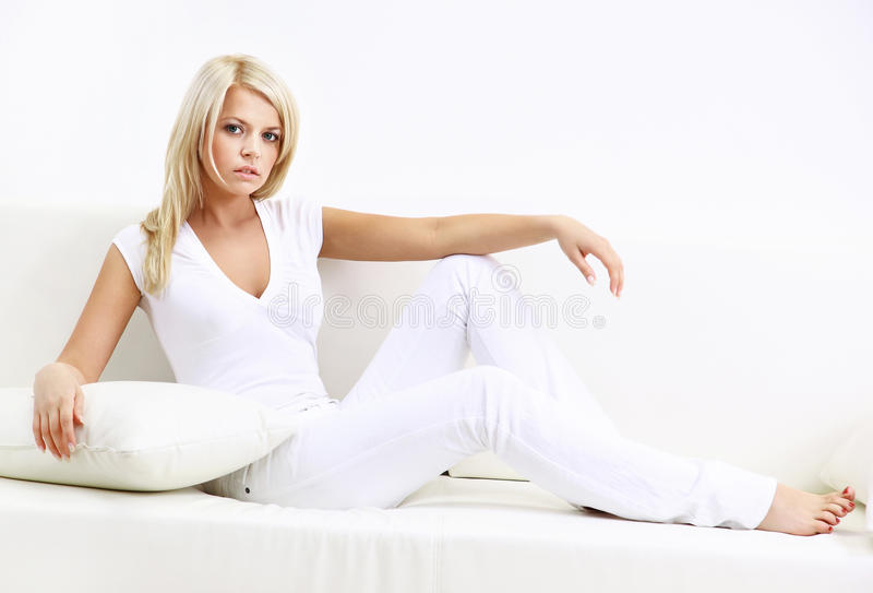 Download Portrait Of Young Woman Sitting At Sofa At Home Stock Photo - Image: 35172734