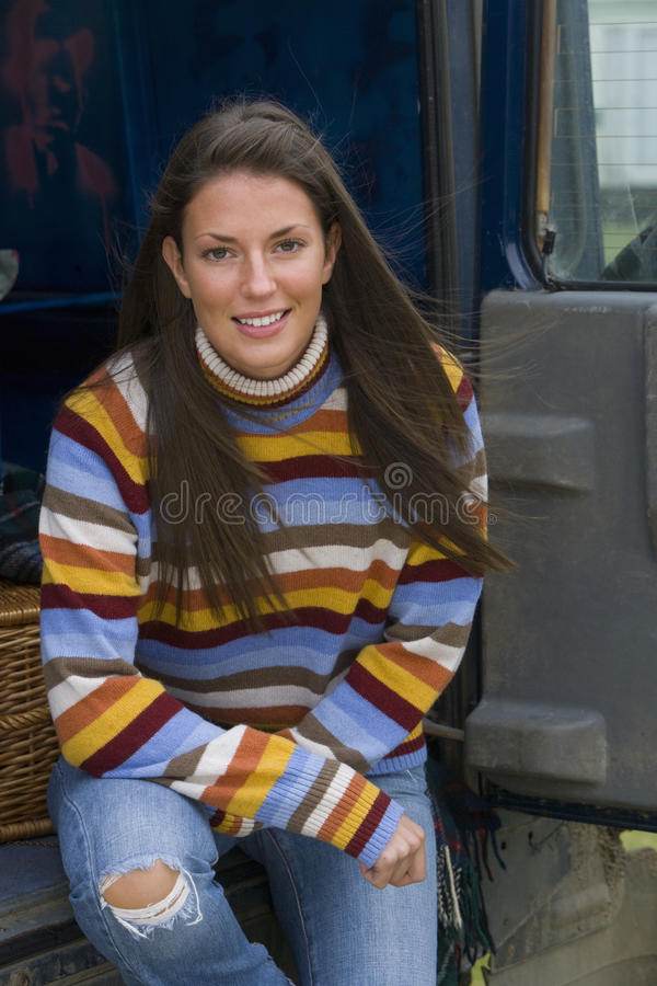 Portrait of young woman sitting in van royalty free stock photography