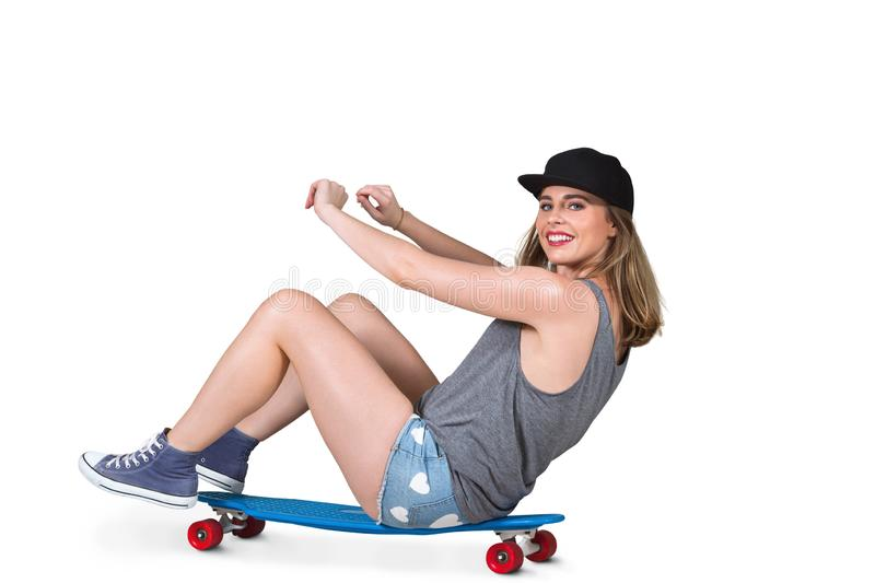 Portrait of young woman with skateboard stock photo