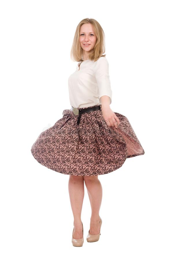 Portrait of a young woman with a skirt circling in full growth isolated over a white royalty free stock photo