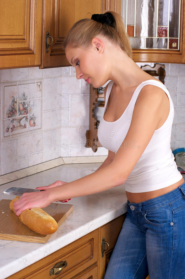 Portrait of young woman slicing stock photo