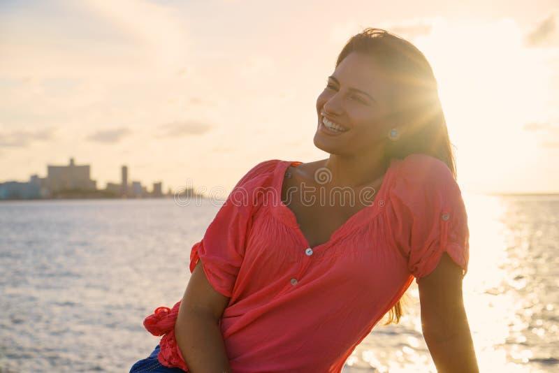 Portrait young woman smile happy sea beauty stock photo
