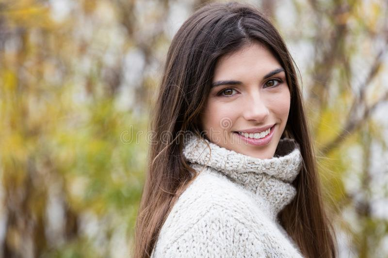Portrait Of A Young Woman Smiling Outside stock photos