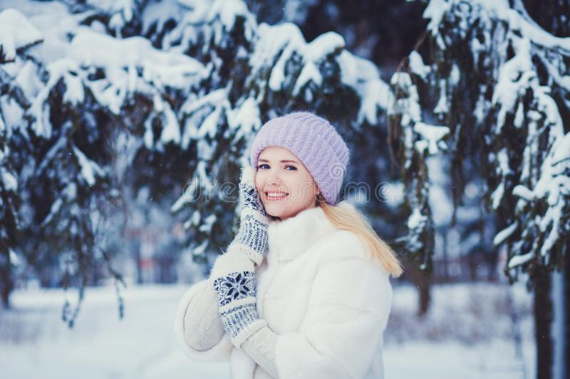 Portrait of a young woman in snow with hands her face. Winter concept royalty free stock photos