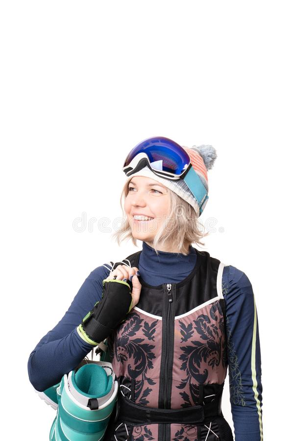 Portrait of a young woman with snowboard boots and glasses stock photography