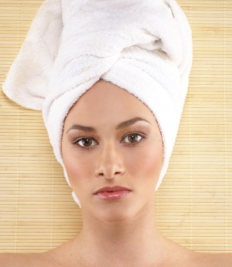 Portrait of a young woman on a spa procedure stock images