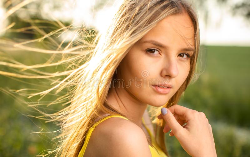 Portrait of young  woman on a spring/summer sunny day stock photo