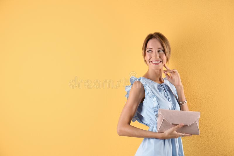 Portrait of young woman in stylish outfit with purse stock images