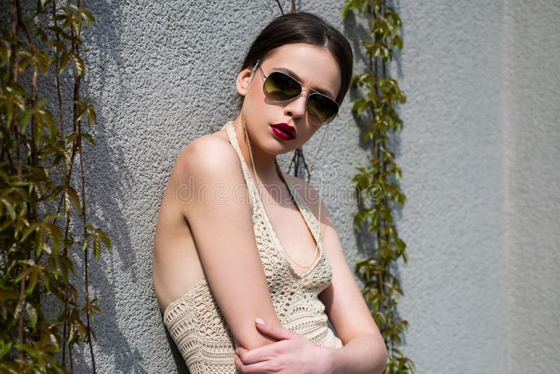 Portrait of a young woman in sunglasses. Close-up portrait of a beautiful charming young attractive woman. Young woman stock photos
