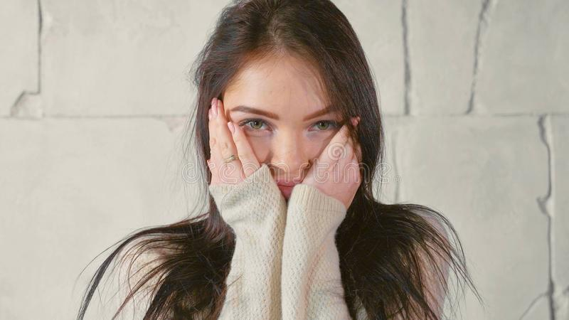 Portrait of young woman in sweater stock photos