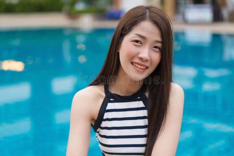 Portrait of young woman in swimming pool royalty free stock images