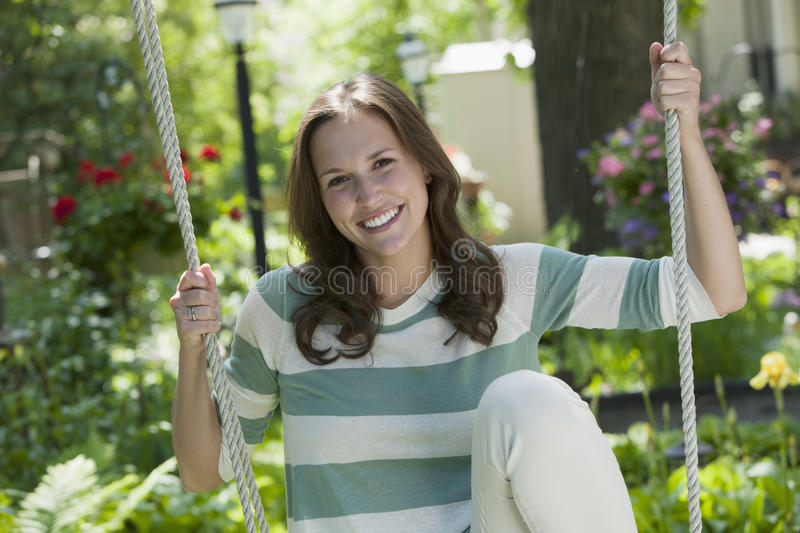 Portrait of a young woman on a swing royalty free stock images