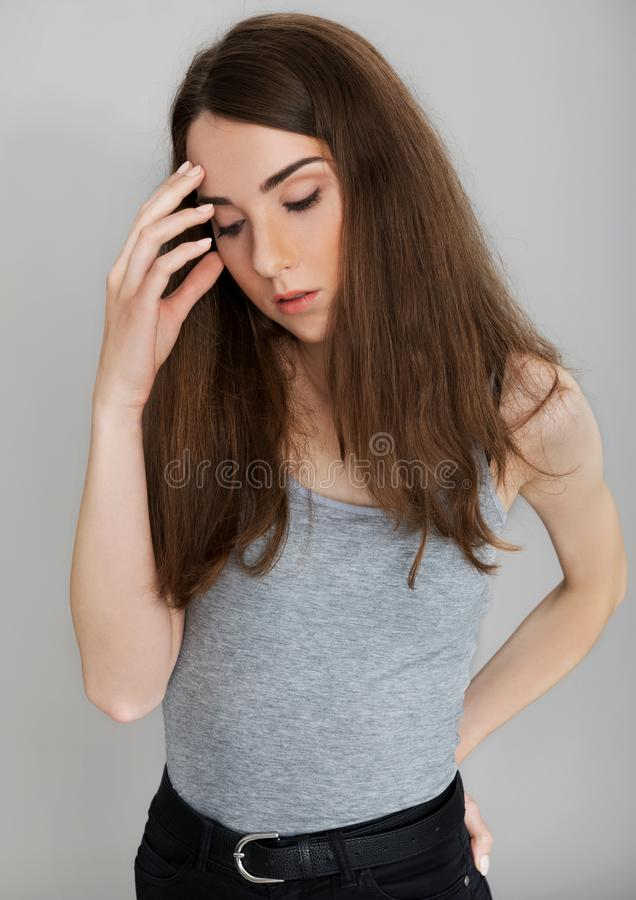 Young woman with headache. Portrait of young woman touching her head, headache concepion royalty free stock photos