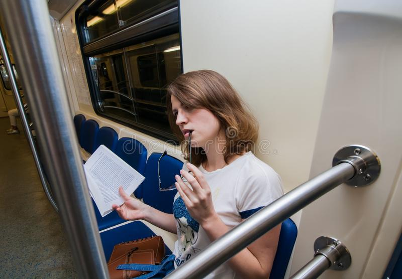Portrait of young woman tourist in metro waggon stock photos