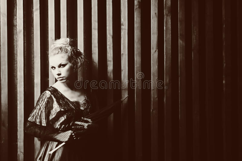 Portrait of a young woman with an umbrella. Retro Style royalty free stock photos