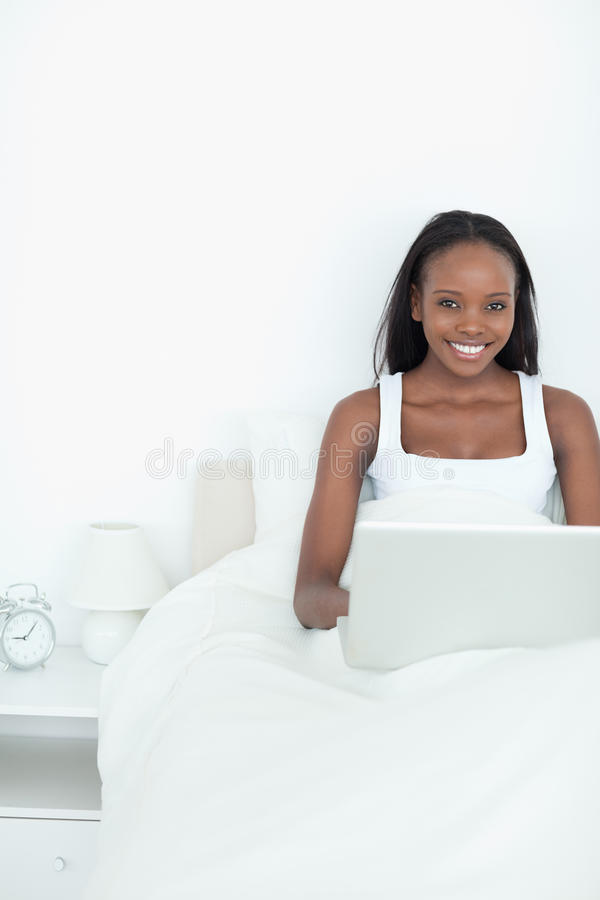 Portrait Of A Young Woman Using A Notebook Stock Images