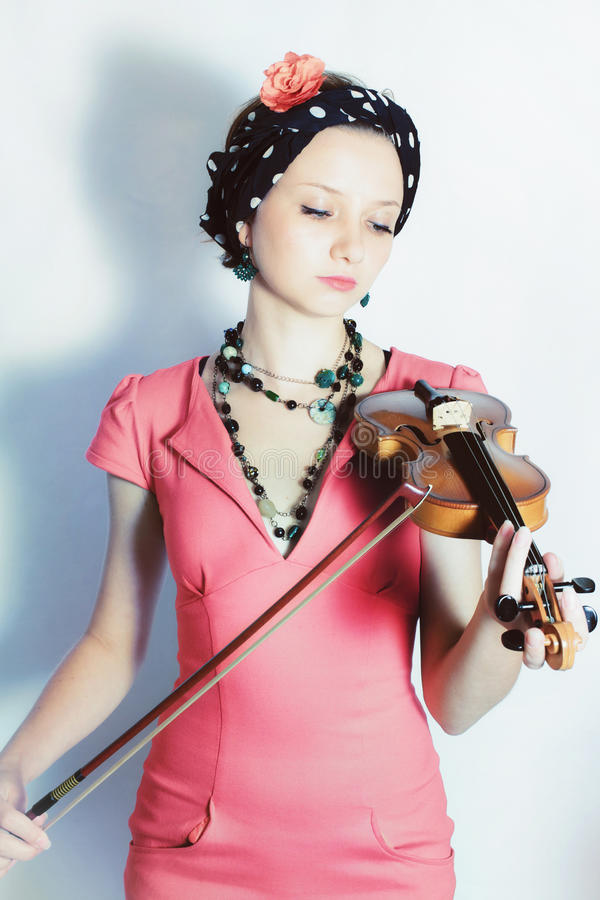 portrait of young woman with violin royalty free stock photo