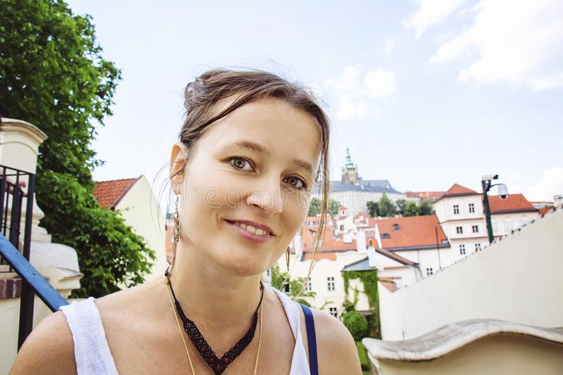 Portrait of young woman visiting Prague royalty free stock image